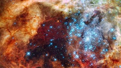 かじき座30星雲(30 Doradus Nebula)で2つの星団が衝突する初期段階のものとみられる画像