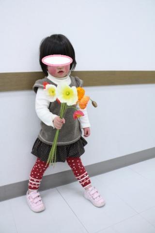 花束を持って