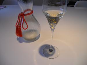 Gold sake in flute glass