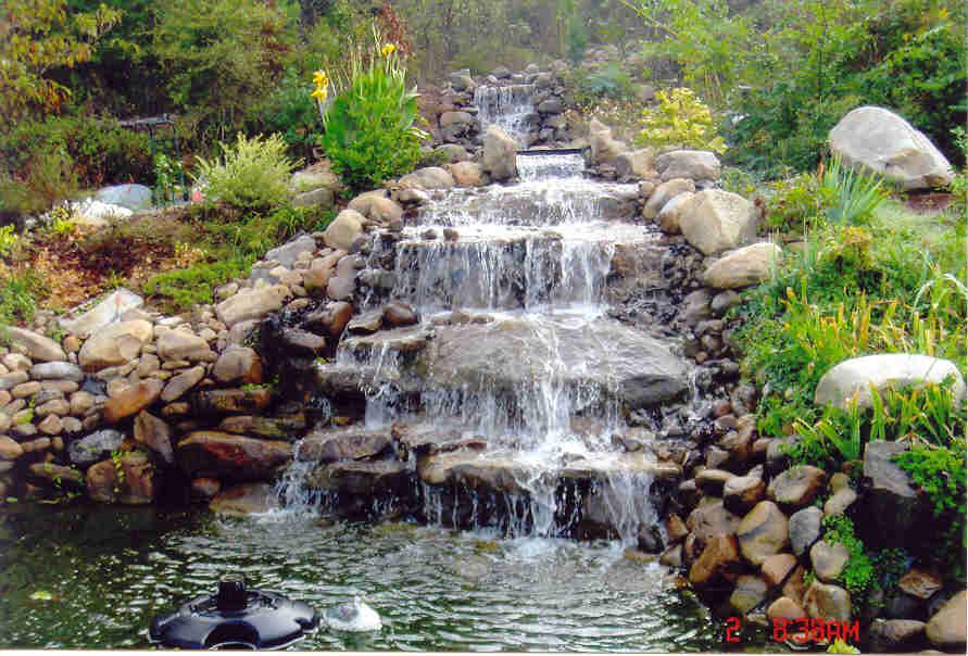 Waterfalls as landscape garden design elements wycepypa for Backyard water ponds
