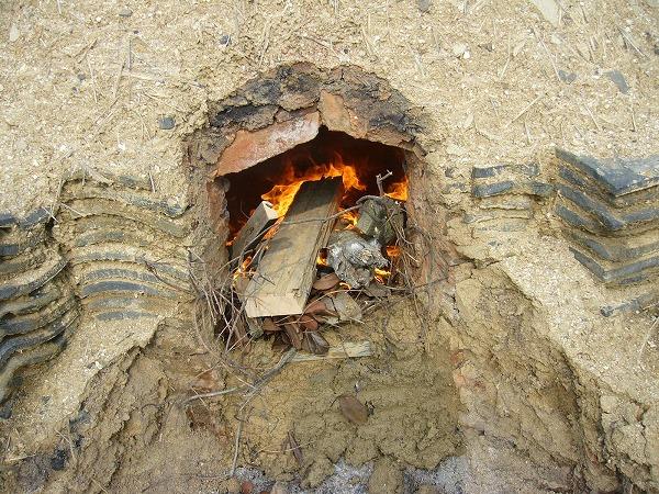 焚口に火入る横