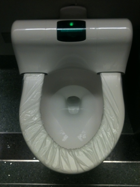 Automatic Toilet Plastic Seat Covers at Chicago O'Hare International Airport