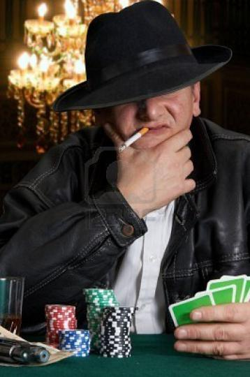 3744500-mafia-type-with-leather-jacket-playing-poker-in-a-classy-casino.jpg
